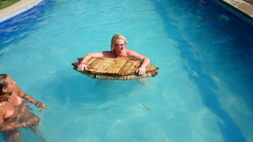 A floating bamboo bar shaped as a surfboard...who doesn't need that in his or her life!?